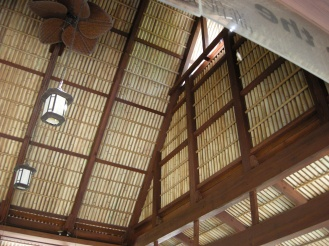Looks like bamboo...it is hand painted, corrugated metal roof.