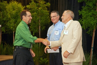 Bob giving donation from Royal Palm Chapter to U.F. SHARE.