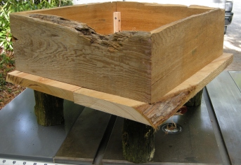 More cypress planks for the base. Added log legs for drainage and to make it easier to move.