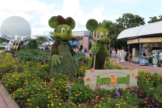 "Mickey and Minnie getting their gloves dirty. Notice the inclusion of vegetable plants and ""garden"" theme."