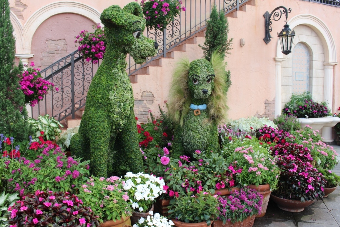 Lady and the Tramp surrounded by flowers in Italian terra cotta pottery.