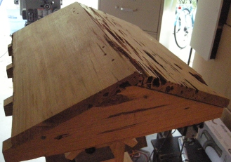 """The first roof was made from 9"""" wide cypress with raw edges but they seemed too short. Their replacements now overhang the rafters."""
