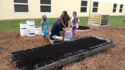 This is what it's all about: Children enjoying gardening.