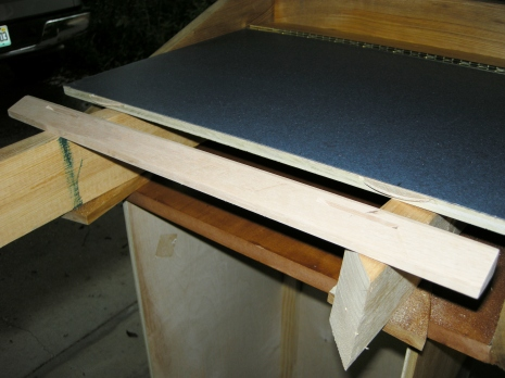 """Applied laminate to the top lid and attached an oak base with """"biscuits"""" and glue."""