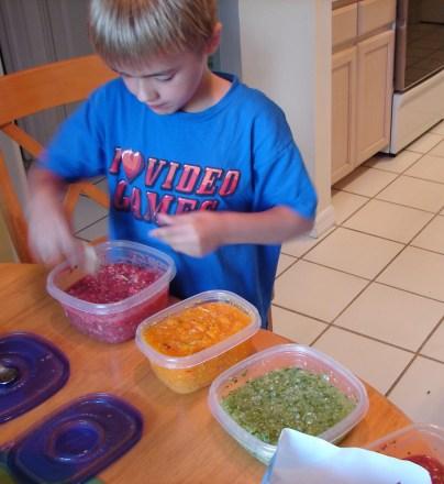 My son John enjoying red, yellow, green salsa.