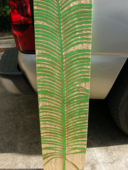 Wood block. I wanted to capture the simple leaf pattern of the Queen Sago leaf. I'll roll on ink and make 6' long prints.