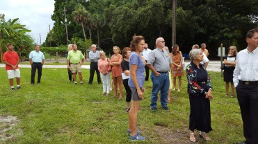 Friends, family and members of the horticulture industry witness dedication of a shade tree in her memory.