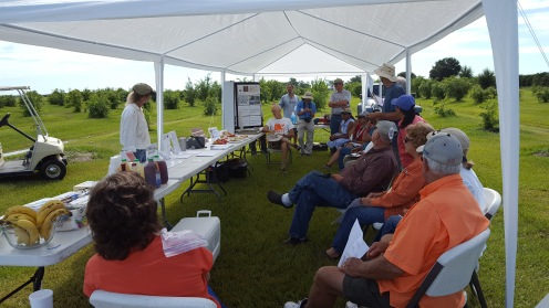 Cindy Weinstein speaks to local growers about her crops.