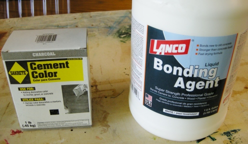 The colorant is dry, to mixed with water. The bonding agent makes the mix stronger, less fragile.