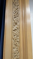 Carved grapevines in the frame of the baptistry.