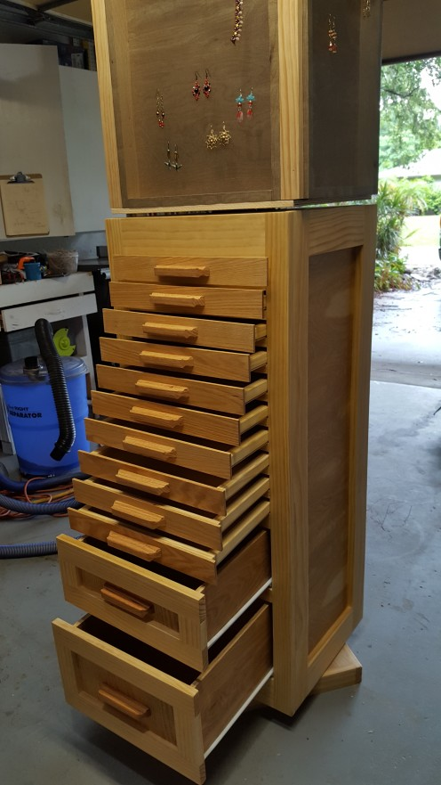Two larger drawers at the bottom ride on metal glides. I finished the exterior with hand-rubbed Danish oil.