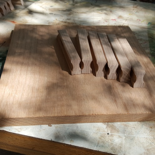 """I made the handles from a 1' square piece of 3/4"""" red oak. Used a round router bit for the groove, then lots of sanding."""
