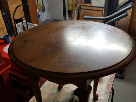 The original table top, scratched and weathered, but with nice legs. Thank you Ethan Allen and the Habitat for Humanity of Sebring, Florida.
