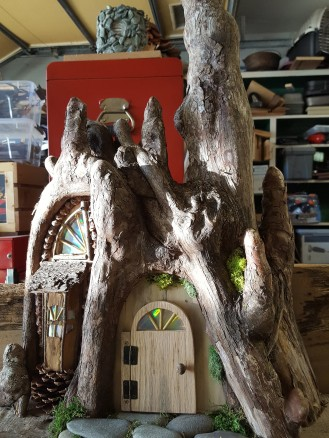 The bay window is made from Melaleuca bark with an oak roof.