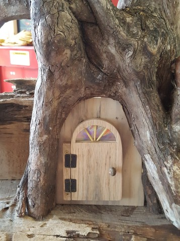 I made the doorway and door from recycled pallet lumber. The door is oak, the knob is a gall on an oak branch.