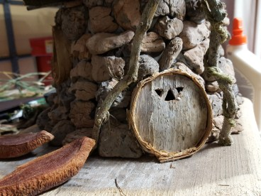 The original front door was Melaleuca bark. I carved three different windows but it ended up looking like a jail door.