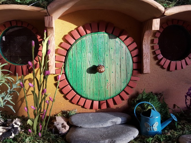 Stepping stones from Landscaper's Choice, Naples. Bird house and watering can from Driftwood Garden Center, Naples and Estero.