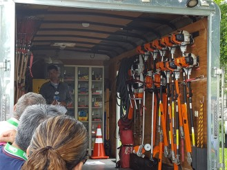 More than just a show: Disney landscape maintenance crew leader shows off their shop on wheels. A crew of 6 men use the tools from this truck every morning. (Typical of a Florida crew, this trailer is equipped with a life preserver.)