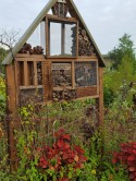 In the pollinator garden, homes for insects.