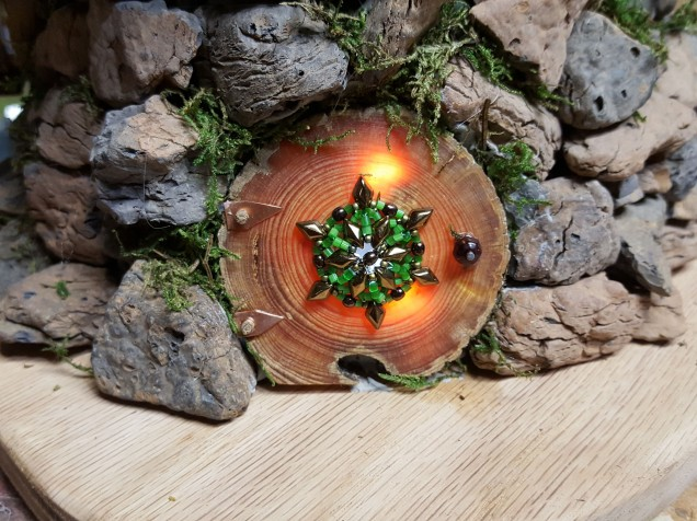 """The front door and windows are cut from the same old pine log. Even though it is about 1/2"""" thick it is translucent to allow some of the light through."""