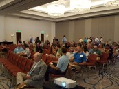 Attendees filing in before the meeting.