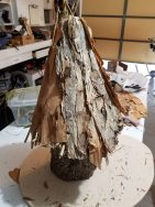 Melaleuca bark attached...but it looks too much like a teepee, so I tore it off and started over.